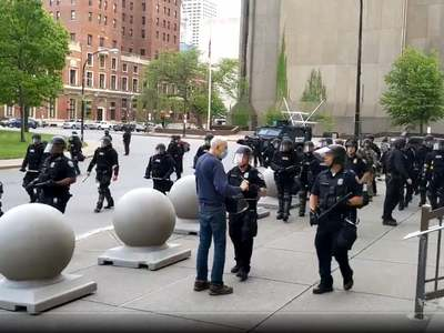 Two US police officers suspended for shoving elderly protester to ground