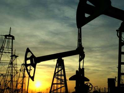 Oil prices hit by record US crude inventories, bearish Fed
