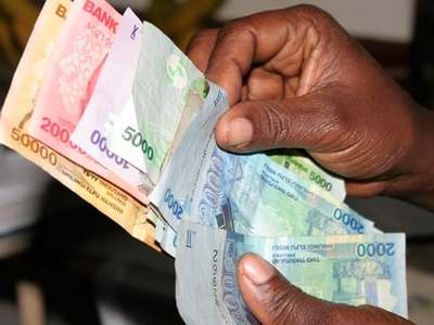 Ugandan shilling inches up as some banks trim positions