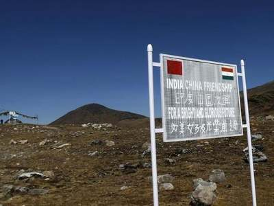 India says China amassed troops along border in violation of agreements