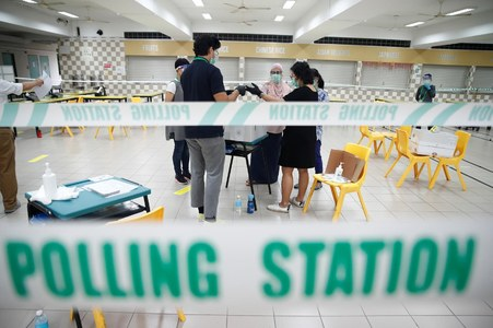 Long lines as Singaporeans in masks vote during pandemic