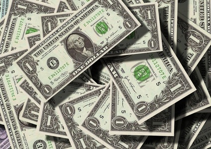 Dollar starts week on back foot ahead of data, earnings