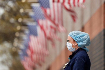 US shatters coronavirus record with over 77,000 cases in a day