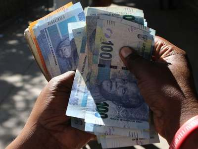 South African rand firms on risk appetite, poor retail sales dent stocks