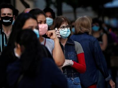 Wear masks outdoors too if distancing can't be maintained: German agency