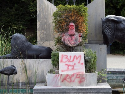 Protests damage statue of Belgian king outside museum