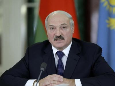 Belarus leader vows to hold fast as tens of thousands march for new vote