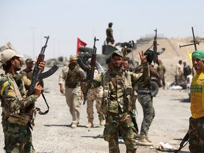 US calls on Iraq to dismantle armed groups