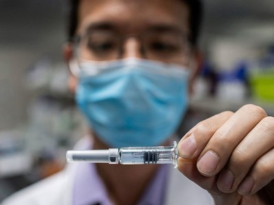 China faces questions over 'vaccinated' workers sent overseas