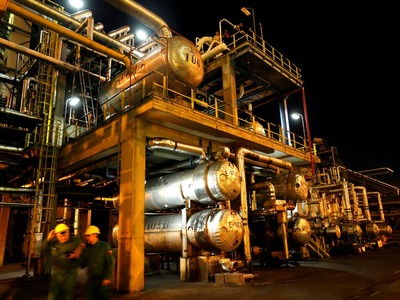 Oil rises on strong factory activity and forecast of a crude drawdown