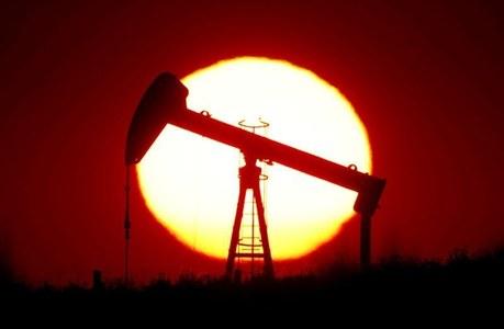 Oil rises as storm closes US production, inventories drop