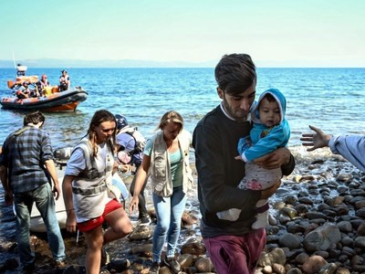 UN urges faster Lesbos asylum rulings as arson suspects charged