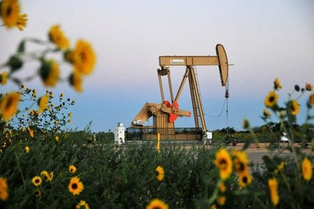 Oil prices steady as third storm in month takes aims at U.S.