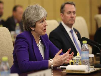 Ex-PM May attacks 'reckless' UK Brexit plan