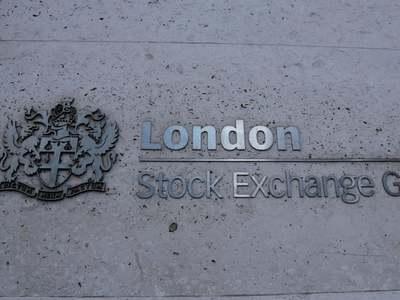 London stocks fall as new pandemic curbs threaten rebound; Cineworld slumps