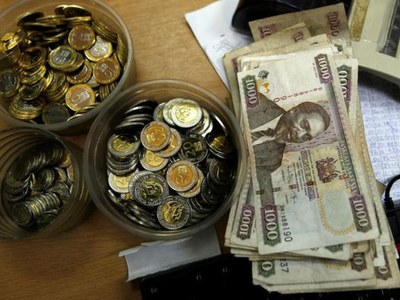 Kenya's shilling inches down against the dollar