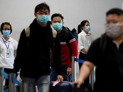 Crowds in masks pack out China auto show after virus delay