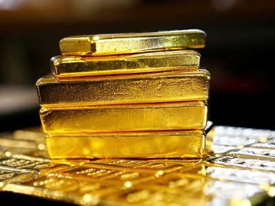 Gold gains on dollar slide, hopes for U.S. stimulus