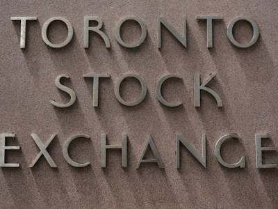 TSX slips at open as materials drag