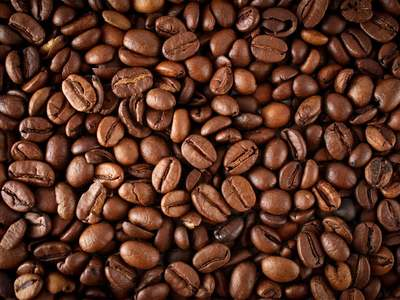 SOFTS-Arabica coffee prices slip as rains aid Brazil crop