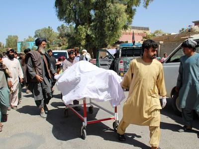 Three dead, dozens wounded in attack on Afghan police base
