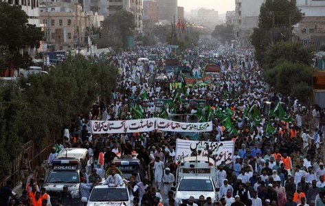 Pakistani police fire teargas at protesters trying to approach French Embassy