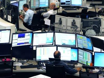 Stocks turn positive in knife-edge US election race