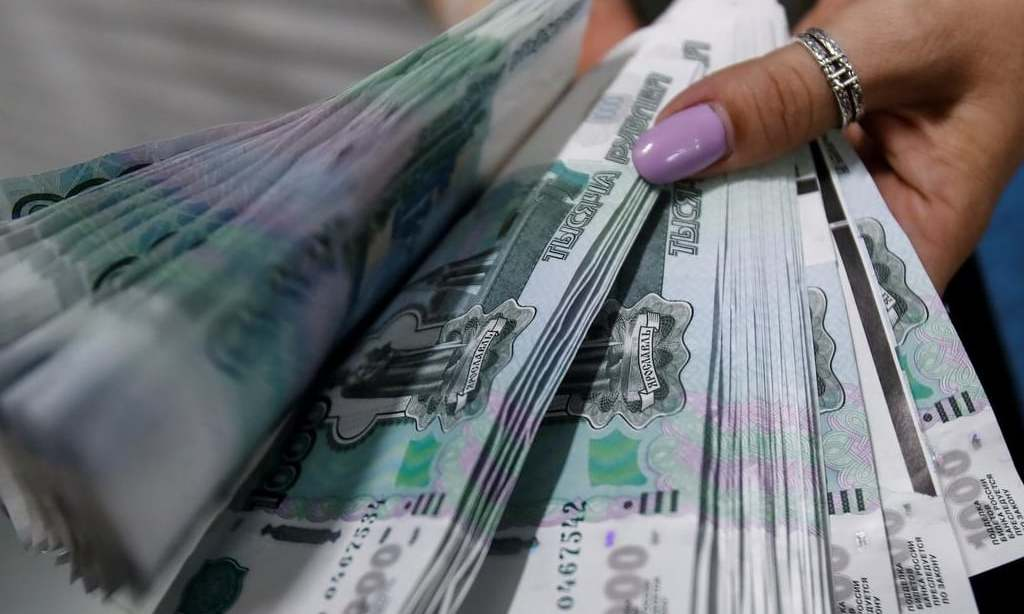 Rouble slips after biggest one-day gain in four years