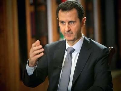 Syria's Assad says U.S. pressure, sanctions obstructing return of refugees