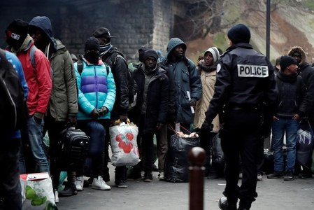 France to probe clashes after police cleared out new Paris migrant camp