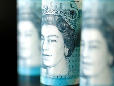 Sterling gains as risk sentiment improves