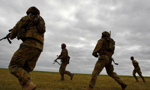 Australia says 13 soldiers told they face dismissal after Afghan report