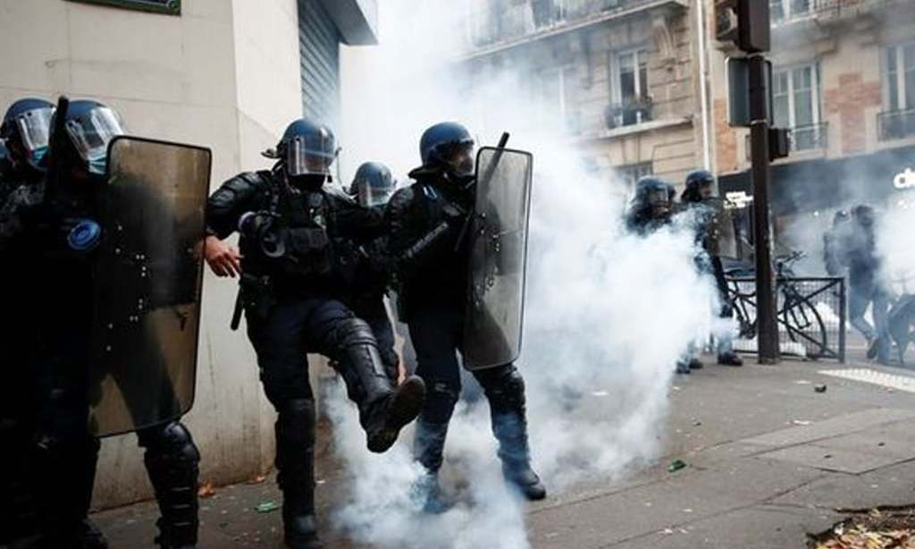 Protesters return to French streets to denounce police violence; tear gas fired