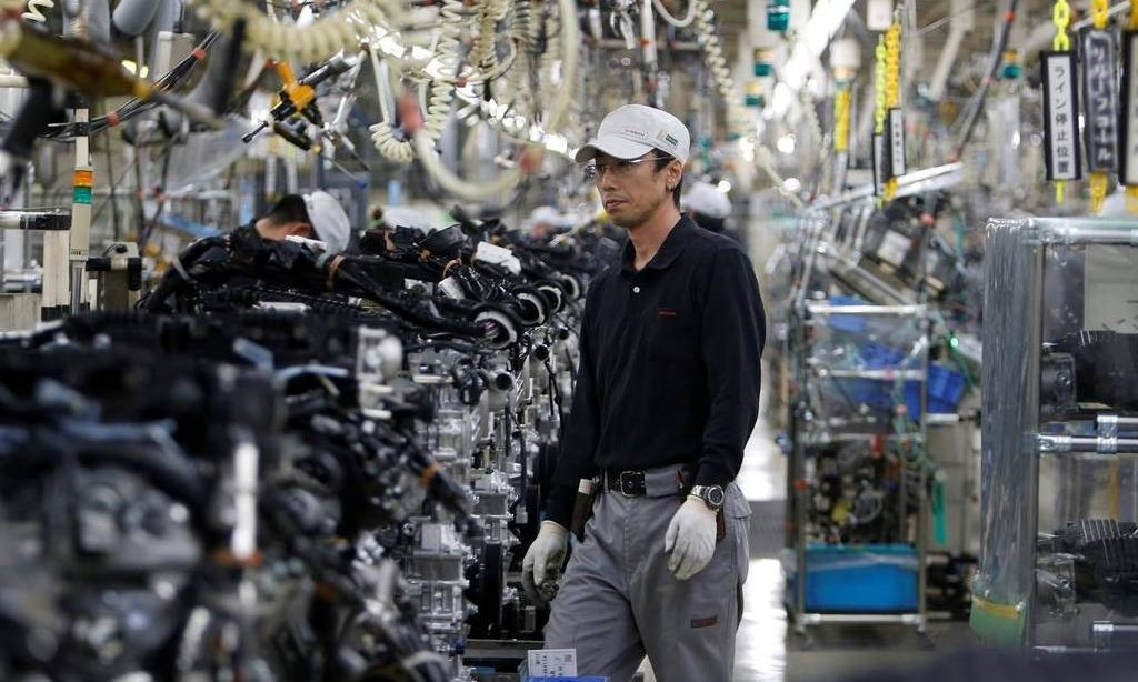 Japanese manufacturers' gloom eases slightly in Dec