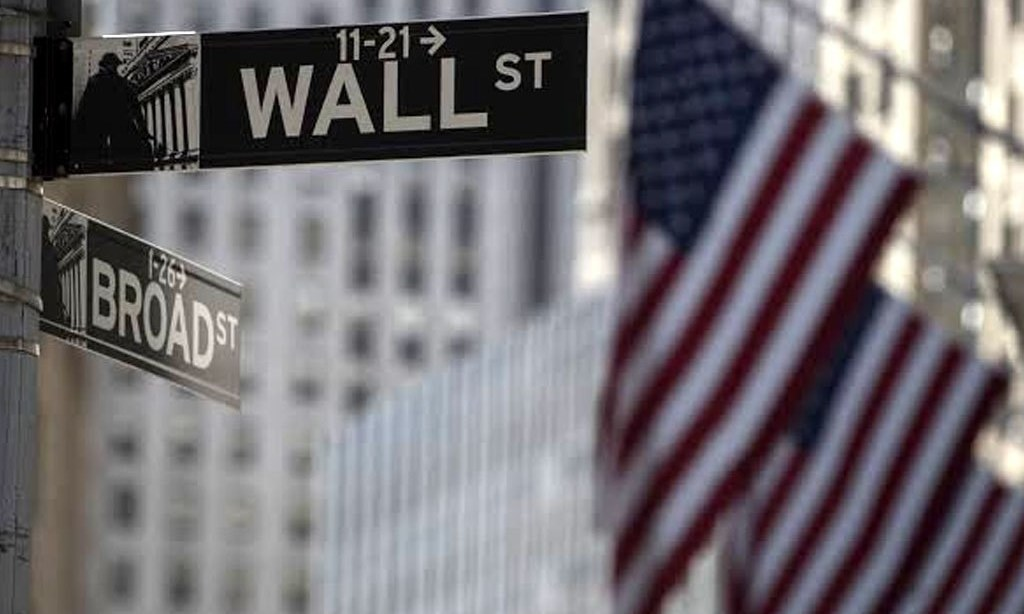 Wall Street dips at open on rising virus cases; eyes on stimulus deal