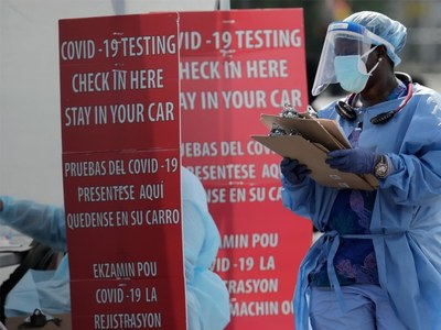 With vaccine drawing closer, US tops 15 million coronavirus cases