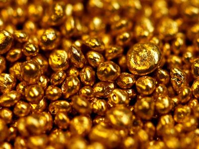 Gold flat as dollar ticks higher, U.S. stimulus talks drag