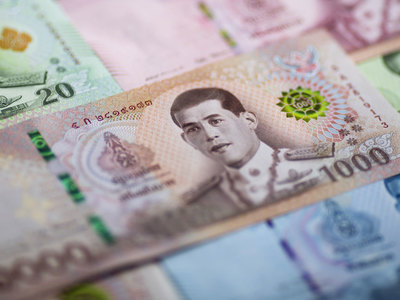 Thai baht dips on suspected central bank intervention; stocks up on vaccine boost