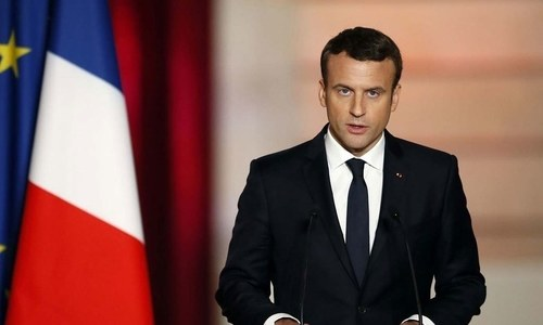France's Macron says mention of climate in constitution will be put to referendum
