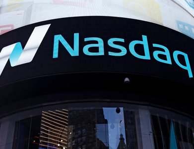 Nasdaq ends at record high as investors await stimulus