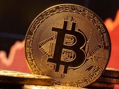 Bitcoin trades near Sunday record of $34,800 following 800% surge