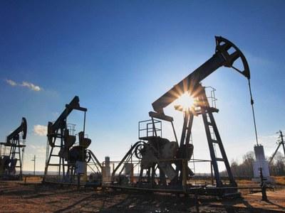 Oil little changed as investors await OPEC+ decision