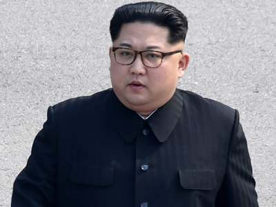 North Korea's Kim poses in military uniform with gun in new portrait