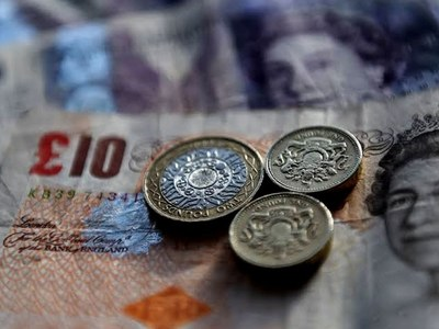 Sterling falls below $1.35