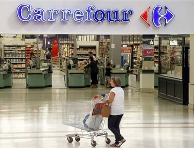 Carrefour shares leap on Couche-Tard merger talks