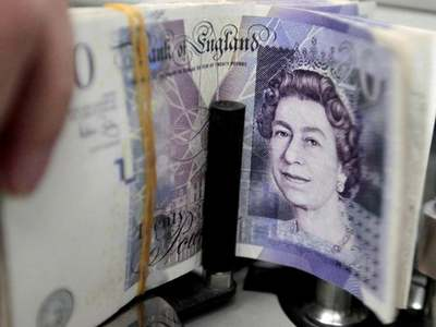 Pound knocked by sour market mood, but set for weekly gain