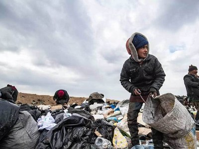Beyond the oil wells, Syrians rummage in trash to survive