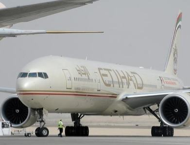Abu Dhabi's Etihad to resume Qatar flights next month