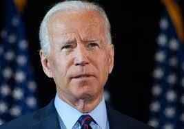 Beaming Biden calls for end to 'uncivil war'