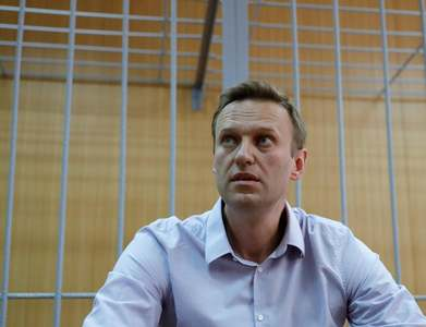 In call, EU chief urges Putin to release Navalny